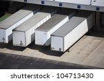 Loading docks and the semi truck trailers - stock photo