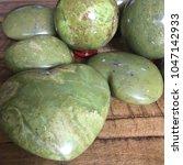 green opal crystal heart on... | Shutterstock . vector #1047142933