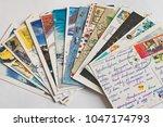 pile of written postcards.... | Shutterstock . vector #1047174793