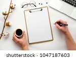 man holding a pen and coffee....   Shutterstock . vector #1047187603