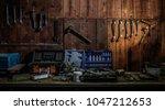 workshop scene. old tools... | Shutterstock . vector #1047212653