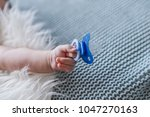 baby with a nipple. close up of ... | Shutterstock . vector #1047270163