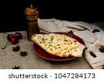 traditional indian naan garlic... | Shutterstock . vector #1047284173