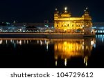 Sikh Golden temple Harmandir Sahib in Amritsar at night, Punjab, India . - stock photo