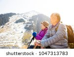 happy asian senior couple... | Shutterstock . vector #1047313783