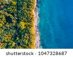 coastal area with blue clear... | Shutterstock . vector #1047328687