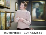 portrait of young woman with a... | Shutterstock . vector #1047332653