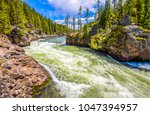 mountain forest wild river... | Shutterstock . vector #1047394957