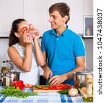 cheerful family couple cooking... | Shutterstock . vector #1047438037