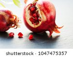 ripe red fruit pomegranate with ... | Shutterstock . vector #1047475357