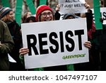 people hold placards and shout... | Shutterstock . vector #1047497107