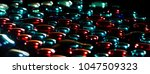 colorful water drops over black ... | Shutterstock . vector #1047509323