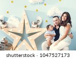 happiness and beautiful family | Shutterstock . vector #1047527173