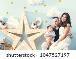 happiness and beautiful family | Shutterstock . vector #1047527197