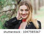 portrait of a blonde woman... | Shutterstock . vector #1047585367