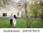 happy couple hold hands running ... | Shutterstock . vector #1047675673