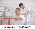 physiotherapy  senior man doing ... | Shutterstock . vector #104784863