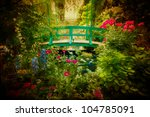 Lovely Monet type garden and bridge with artistic texture effect. - stock photo