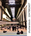 Small photo of LONDON - MARCH 16, 2018: Visitors interact with the 'One Two Three Swing!' exhibtion by Danish artists' collective SUPERFLEX inside the Turbine Hall of Tate Modern art gallery in Bankside, London, UK.
