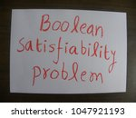 Small photo of Text Boolean satisfiability problem hand written by red oil pastel on white color paper