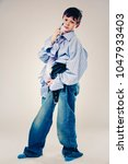 caucasian boy wearing his dad's ... | Shutterstock . vector #1047933403