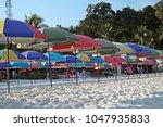 colorful sunshades on the beach | Shutterstock . vector #1047935833
