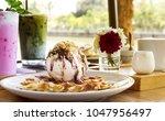 big scoop vanilla icecream...   Shutterstock . vector #1047956497