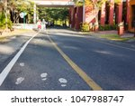 foot symbol on walk way or foot ...   Shutterstock . vector #1047988747