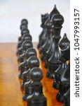 chessmen on the board   Shutterstock . vector #1047993157