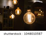 old dusty round orange light...   Shutterstock . vector #1048010587
