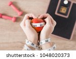 woman's tied hands with a...   Shutterstock . vector #1048020373