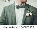 a groom in grey suit and white... | Shutterstock . vector #1048055953