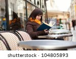 beautiful young woman reading a ... | Shutterstock . vector #104805893