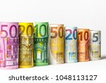 several hundred euro banknotes... | Shutterstock . vector #1048113127