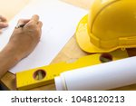 architect drawing blueprint of... | Shutterstock . vector #1048120213