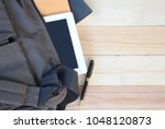 book and notepad in shoulder... | Shutterstock . vector #1048120873