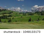 summer in alpe di siusi seiser... | Shutterstock . vector #1048133173