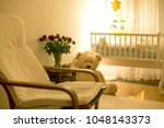 empty rocking chair in a baby... | Shutterstock . vector #1048143373