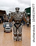Small photo of Frome, Somerset, UK - September 10, 2016: Standing at over two metres tall Titan The Robot entertains the crowd at a very wet Frome Agricultural & Cheese Show at the West Woodlands Showground