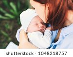 loving mother with her newborn... | Shutterstock . vector #1048218757