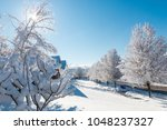 winter season in city  road and ... | Shutterstock . vector #1048237327
