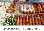 Street Vendor Cooking Bacon...