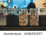 jars with dry herbal tea | Shutterstock . vector #1048352557