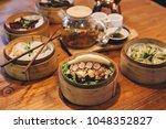 bao bun sandwich served with... | Shutterstock . vector #1048352827