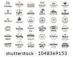 vintage retro vector logo for... | Shutterstock .eps vector #1048369153