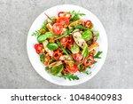 fresh vegetable salad plate of... | Shutterstock . vector #1048400983