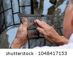 Small photo of A man is cleaning air-conditioner air filter by himself.