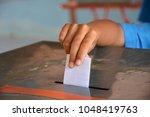 students drop the ballot box. | Shutterstock . vector #1048419763