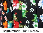 tropical sarong on display in... | Shutterstock . vector #1048435057