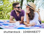 loving young couple in the park ... | Shutterstock . vector #1048448377